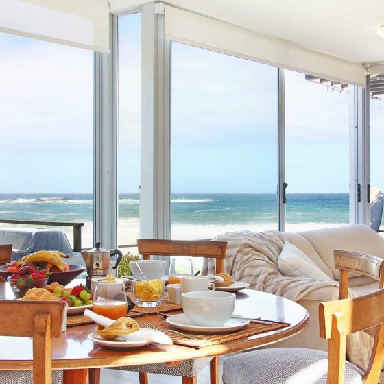 11.US VIE OVER DINING TABLE TO BEACH