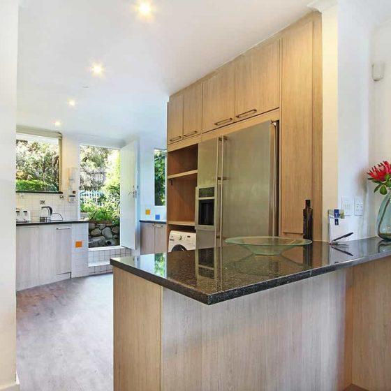 40.DS. Kitchen fridge behind granite